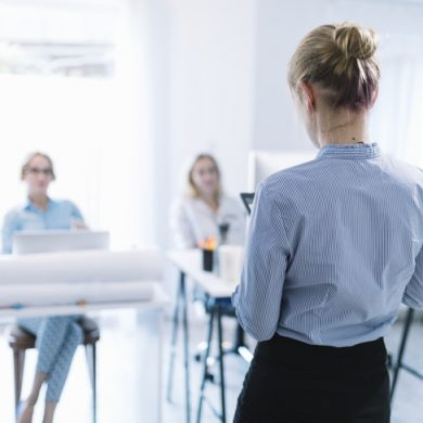 rear-view-businesswoman-giving-presentation-meeting_23-2147955150